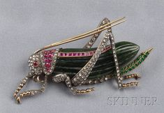 Nephrite Jade, Diamond and Gem-set Insect Brooch, the fluted jadeite body with rose-cut diamond legs, cabochon and step-cut ruby highlights, emerald melee accents, silver-topped gold mount, lg. 2 3/4 in.  Estimate $1,000-1,500