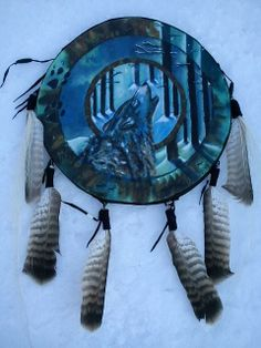 Wolfshield oil on rabbit hide decorated with hawk feathers...Painted on a trip to Sweden travelling and sleeping in nature..