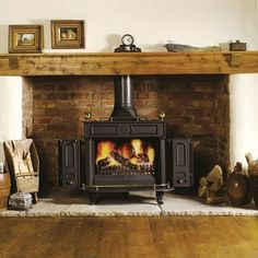 50 Fabulous Country Living Room Design Ideas With Fireplace Mantle - Trendehouse Brick Fireplace Mantles, Candles In Fireplace, Fireplace Surrounds, Fireplace Design, Fireplace Ideas, Cottage Fireplace, Fireplace Shelves, Stone Fireplaces, Small Fireplace
