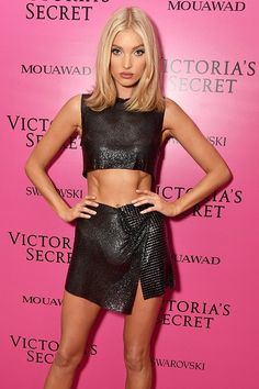 Elsa Hosk is STUNNING in a metallic black crop top and a matching skirt!