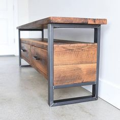 Store your media devices and accessories in this two-drawer, two-shelf reclaimed media console with steel legs. With plenty of space to hold your large television and media components, this unit will fit perfectly in your home. Made with authentic reclaimed barn wood and finished with an