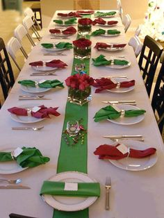 12 Winter Table Centerpiece Ideas for Christmas Day White table cloth with red green napkins place in white plates, long green wide ribbon down center of table with short glass containers holding red flowers, could use floating candles in water. Christmas Table Settings, Christmas Tablescapes, Christmas Table Decorations, Holiday Tables, Christmas Party Centerpieces, Christmas Party Table, Church Decorations, Wedding Decorations, Christmas Table Cloth