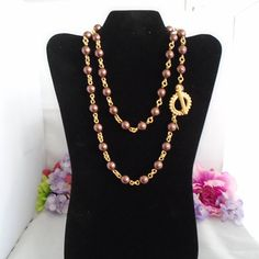 Vintage Joan Rivers Beautiful 34 Bronze/Copper/Brown Long Pearls Necklace with a gorgeous Gold Plated Toggle Clasp. This Beautiful Signed JOAN RIVERS, Bronze Copper and Brown Large Pearls may be worn long or doubled! This is a Classic Necklace and one that you would be lucky to