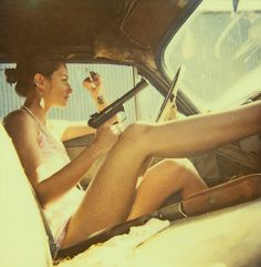 PULP ART BOOK  BONNIE SERIES  Photo by Neil Krug - Vintage Modern photography. I love the camera angle. Shotgun, Legs, Pistol, and cigarette in hand.