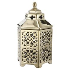 Tuck a tealight into this openwork candle lantern to cast a warm glow over a romantic dinner or evening yoga practice.Product: Ca...