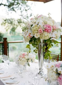 Gorgeous lush tall  low centerpieces in whites  pinks. Calistoga Ranch Wedding, Napa. Floral Design by Fleurs de France. Photo: Meg Smith