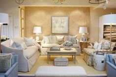 Family room vignette at our Baltimore shop filled with light blue accent pieces // Kellogg Collection