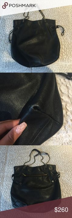 #ToryBurch hobo #purse 100% authentic. (1st transaction fell through) Black. Gold chains. Bought st Bloomingdales. Inside perfect condition. Outside has 1 scratch as shown and a little color wear on corners but nothing that's visible. Has a lot of life left in it.  Don't have the dust bag. I can sell it for a little less but not on here. Contact me through my IG: @ shopmydressnow Tory Burch Bags Shoulder Bags