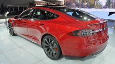 The Tesla Model S P85D is a crimson beauty at the 2015 Detroit Auto Show with 691 horsepower and carbon fiber touches.