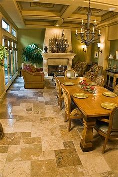 The Slate Floor In Dining Room Gets A Stone Pebble Border Which Transitions Into Florida Tile That Mimics Maple Hardwood Photo By Mosb
