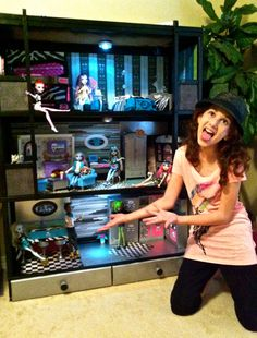 DIY Monster High Dollhouse.  Took an old Barbie house and turned it into Monsterful Mansion!  :)