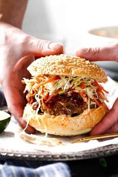 These crazy juicy Asian Burgers are bursting with flavor AND they can be on your table in minutes! The smothering of Hoisin Ketchup, Garlic Chili Mayo and Asian Slaw take this burger to a whole new level of delicious!