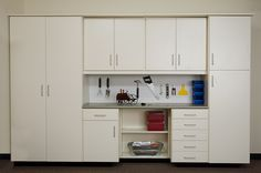 Finding creative ways to manage your home storage is so important; Closets by Design can help you do this with our custom Garage Cabinets. Any garage can be maximized to hold more than you might image with Tall Storage Cabinets, Upper Cabinets, Drawers and Shelves. Shown here with a Laminate Countertop with study Pegboard Backing for organizing your tools above the Workbench. #ClosetsByDesign