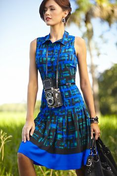 Fun and sophisticated belted dress with a bold print and pleated waist. #beallsflorida