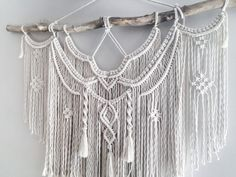 Large Macrame Wall hanging A fusion knots and of course lots of fringing! The star of this piece is a beautiful long branch. Your piece is made by hand using natural unbleached cotton and revived branches from local woods in Upstate NY and the Adirondacks. ✨✨✨ SIZING She measures roughly 44in x 45in (including the branch) so she is sure to stand out wherever you choose to hang her. Sizing is approximate: Branch Width - 44 Macrame Length - 40 Rope hanger- 5 ✨✨✨ MADE TO ORDER I will repl...