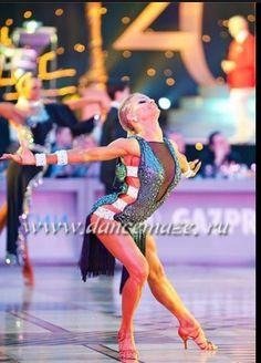 Yulia.  You can feel the energy and movement in all of her photos. #ballroom #BallroomDance #YuliaAndRiccardo