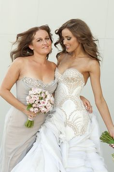 bride Rebecca Judd and one of Her Bridesmaids both in J'aton Couture