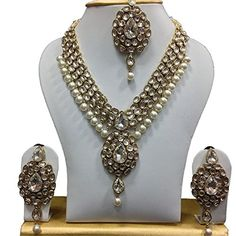 Indian Bollywood Gold Plated White Pearls Traditional Kun... https://www.amazon.com/dp/B01J36AZVU/ref=cm_sw_r_pi_dp_U_x_id4fBb6HXG0MB