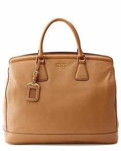 OK, so maybe the bag isn't sooo bad, but the day I pay $1500.00 for a bag on sale, is the day someone needs to take me out and shoot me. Prada Cervo Leather Shopping Tote