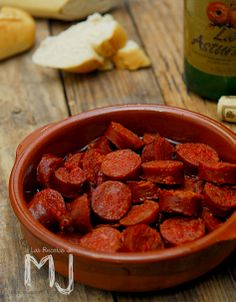 "Chorizos a la sidra. Spanish sausages ""chorizos"" slowly cooked in cider. Dish from Asturias and Cantabria, very popular all over Spain."
