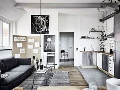 The organized chaos of an artist studio meld beautifully with the living space in this bright apartment.
