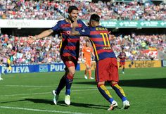 Luis Suarez of FC Barcelona celebrates with Neymar after scoring his third goal during the La Liga match between Granada CF and FC Barcelona at Estadio Nuevo Los Carmenes on May 14, 2016 in Granada, Spain.