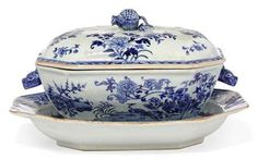 A CHINESE EXPORT BLUE AND WHITE SOUP TUREEN WITH COVER AND STAND   QIANLONG PERIOD (1736-1795)   With rabbit-shaped handles, painted with peacocks amongst oversized peony sparys and further blossoms, the cover with a pomegranate finial, the stand with similar design