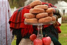 Apple cider donuts piled high on vintage cake stands - a perfect finish to a crisp Fall picnic!