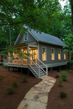 A 1,091 sq ft tiny house with two porches, a stunning interior, and…