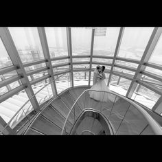 Is this the highest kiss in a man made structure ?  Yvonne and Las a #german couple wanted to celebrate their wedding @atthetop of #burjkhalifa.  At the top of the world... Behold the grand stair case at the 140th floor.  They knew they were supposed to comply with the laws of the land and not #kiss... I told them not to kiss but to stop just before they kissed to capture an image... But guess what they did... they kissed... Phew !!! No one saw except my camera... Shot with #canon 5d mark 3…