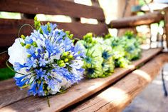 Blue bridal bouquet featuring agapanthus and white hydrangeas