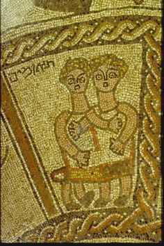 Gemini depicted by 2 boys in one tunic. Their inner arms are crossed.  Their bodies are seen from the front, their legs are seen in profile. תאומים inscribed in the upper left corner. The panel is framed on three sides by guilloche bands and on the left by a plain band. Beth Alpha Synagogue. Artist/ Maker: Marianus and his son Hanina (Artisan). Date: 518-527, Justin I, or 567-578, Justin II. Period: Byzantine. Origin: Israel/Eretz Israel | Palaestina Secunda | Beth Alpha