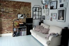 fairy lights, exposed brick, lots of frames, plenty of white. heaven.