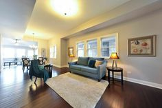 Remodeled Living Room Example, Hardwood Floors, Neutral Paint, Area Rug, Gorgeous Accents