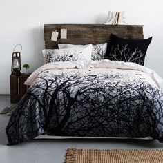 I really like the rustic bedhead - looks like it was made from old fence palings. I especially like the little shelf on top - a good place for the bedtime reading material!: