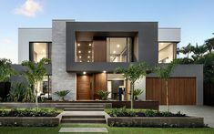 Queensland living at its finest!The breathtaking Signature Riviera Residence from a luxury contemporary home designed specifically for sub-tropical coastal lifestyles. Featuring our Mexicana Grey series and Ultraslim Statuario Modern Exterior House Designs, Modern House Facades, Dream House Exterior, Modern House Plans, Cool House Designs, Exterior Design, Best Modern House Design, Modern Villa Design, Exterior Colors