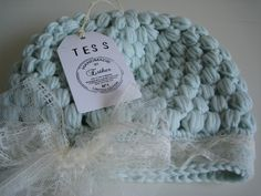 Love the color and lace on this baby beanie...