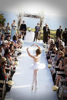Ballerina goes down the aisle en pointe before the bride's debut. This would be even more beautiful with an Irish dancer doing a slip jig.