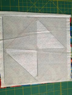 """On the back of a light colored fabric (9"""" for 3"""" finished or 11"""" for 4"""" finished square) draw an 8"""" square (or 10"""" for 4"""" finished) in the center of the fabric."""