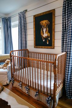Simple and boyish make a great nursey design- love the pet portrait and checked draperies