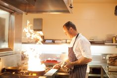 Executive Chef Leigh Dundas hard at work showing us how to flambe with style in the dish Restaurant kitchen at the Royce Hotel Melbourne
