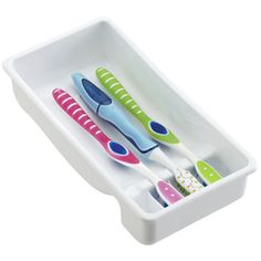 Toothbrushes Out Of Sight, Protected In A Drawer, Separated From Each  Other, And