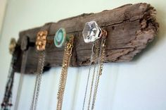 Or you can collect Anthropolgie knobs and make a jewelry display on a rustic piece of wood like this...love it! www.twosimplepeople.com