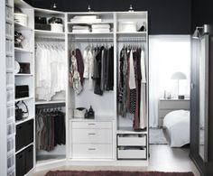 The Ikea Pax Wardrobe System being used without doors to create a custom walk-in closet.