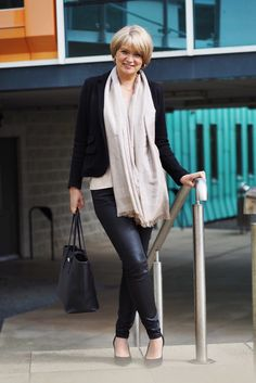 Straight out for a date night after work. The gold lustre t-shirt and coated jeans were fine worn in the office with a black jersey blazer. The addition of heels and a gleaming gold scarf helped to transform the outfit for an evening event.