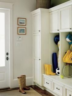 Simple mudroom idea... Like the closed cabinet cubbies above the lockers