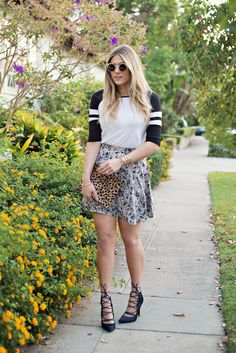 The Magic Floral Skirt, style it with a baseball tee or casual top, strappy heels, and a fun printed clutch for the ultimate #OOTD. #DevonRachel