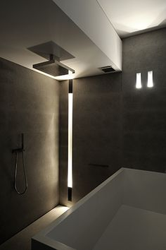 Minimalist bathroom with subtle lighting design and clean lines _