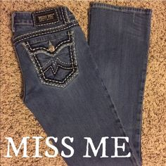 """""""Irene"""" Miss Me Jeans Low rise zip fly stretch jean Slim through the hip and thigh Bootcut 18"""" bottom opening Embroidered back flap pockets Grinding, tacking, dremmeling and hand sanding details Leather Miss Me label on back Miss Me Jeans Boot Cut"""