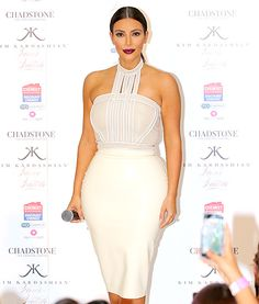 So demure! Kim Kardashian covered up in cream separates while promoting her Fleur Fatale fragrance in Melbourne.